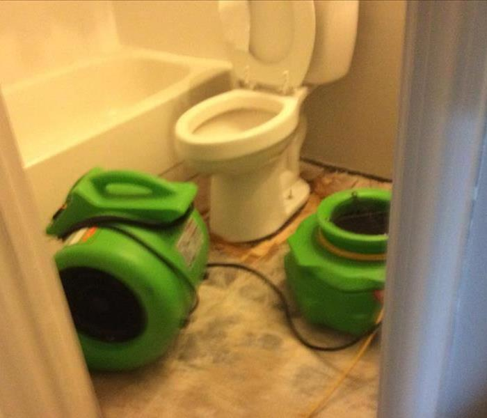 Water damaged bathroom requires professional mitigation Before